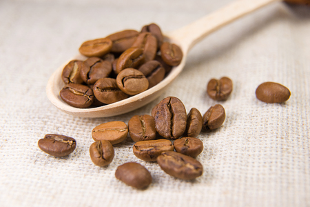 tipple: a lot of roasted coffee beans in the spoon