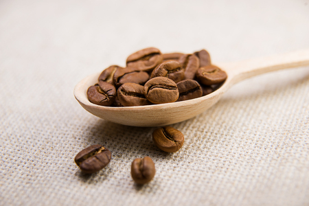 vigor: a lot of roasted coffee beans in the spoon