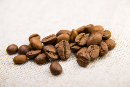quencher: A lot of roasted coffee on a tablecloth
