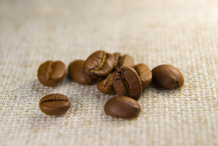 buoyant: A lot of roasted coffee on a tablecloth