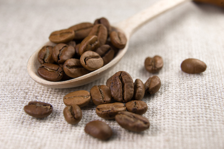 buoyant: A lot of roasted coffee beans in the spoon Stock Photo