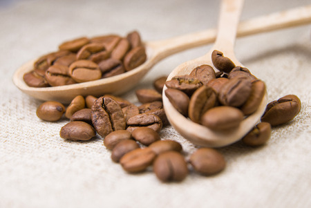 buoyant: A lot of roasted coffee beans in the spoons