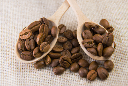 quencher: A lot of roasted coffee beans in the spoons