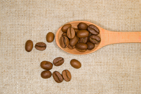 pip: A lot of roasted coffee beans in the spoon Stock Photo
