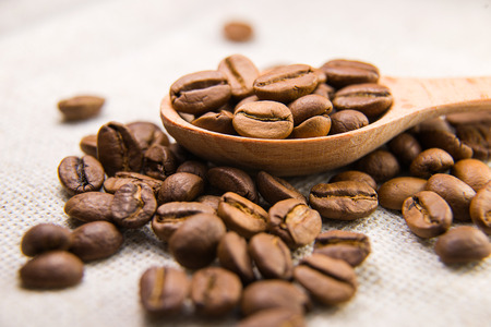 strenuous: A lot of roasted coffee beans in the spoon Stock Photo