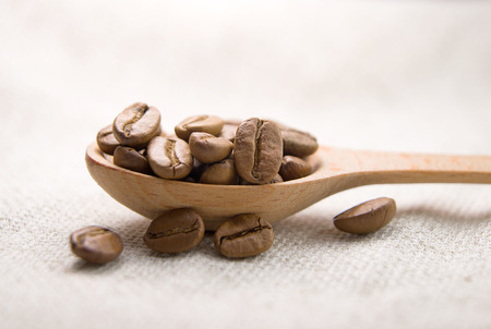 tipple: A lot of roasted coffee beans in the spoon Stock Photo