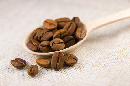 potation: A lot of roasted coffee beans in the spoon Stock Photo