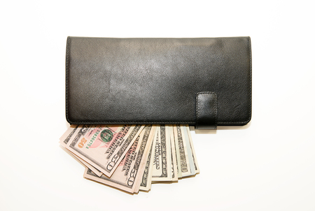 acquiring: Black leather wallet with banknotes of US dollars inside Stock Photo