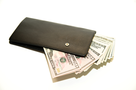 billfold: Black leather wallet with banknotes of US dollars inside Stock Photo