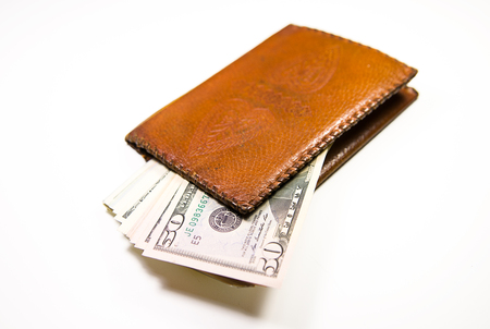 acquiring: Old leather wallet with banknotes of US dollars inside