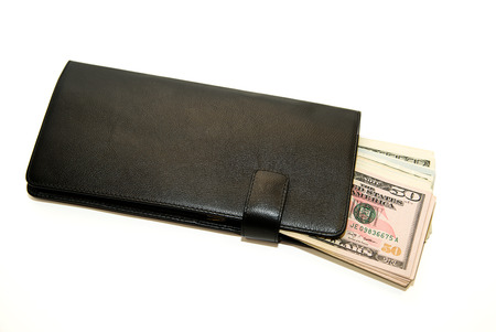 obtaining: Black leather wallet with banknotes of US dollars inside Stock Photo