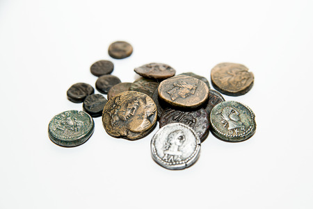 numismatics: A lot of old  coins with portraits of kings on a white background