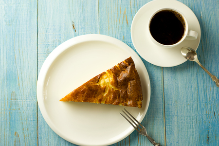 quencher: Piece of cake on a white plate on over blue Stock Photo