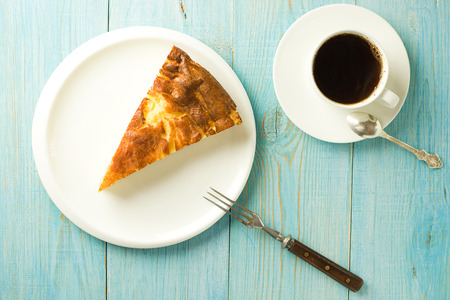potation: Piece of cake on a white plate on over blue Stock Photo