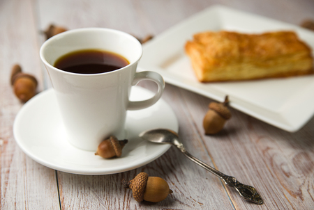 quencher: Cup of coffee, sweet buns and brown acorns