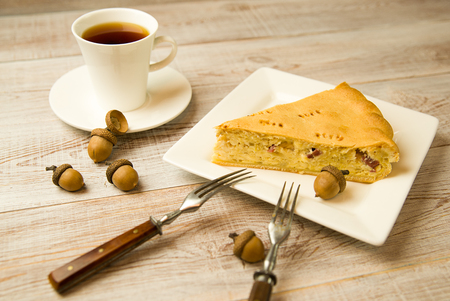 aliments: Cheese cake and a cup on the table