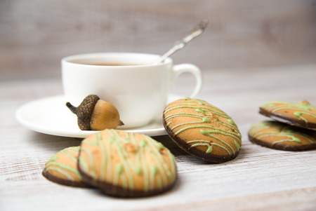 potation: A cup with a drink and chocolate chip cookies on the table Stock Photo