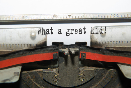 glorify: Sheet of paper with the inscription What a great kid!  in the typewriter