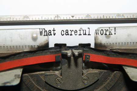 glorify: Sheet of paper with the inscription What careful work!  in the typewriter