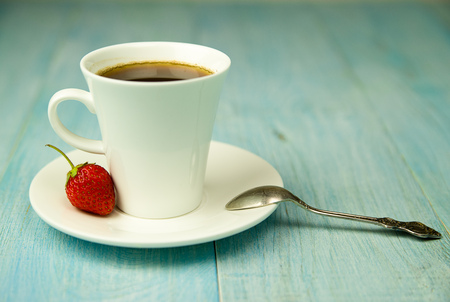 potation: Cup and strawberry on over blue Stock Photo