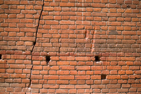 crack house: A crack in the wall of the old brick house