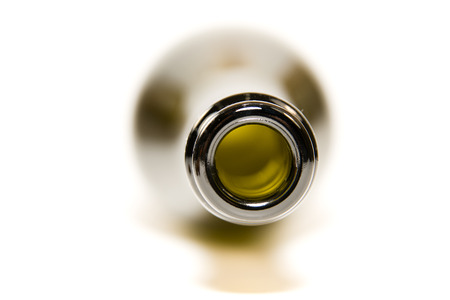 tipple: The edge of the neck of the glass bottle on white