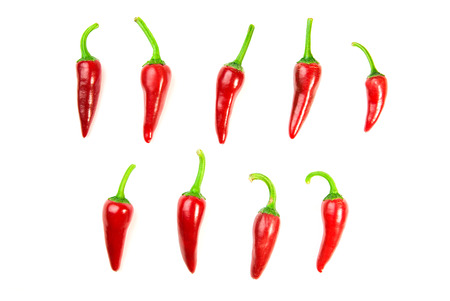 poignant: Many ripe red Chilli peppers on over white Stock Photo