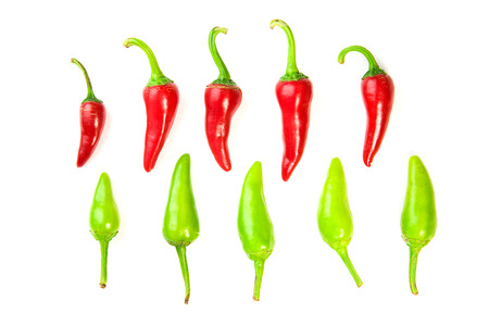 poignant: Many ripe red and green Chilli peppers on over white