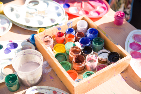 gouache: Jars with gouache paints are on the table