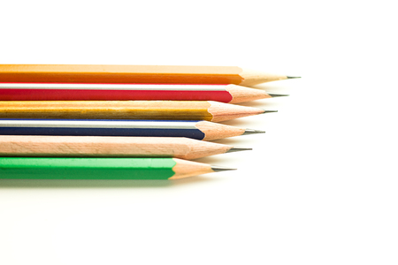 Pencils of different colors are on over white. Stock Photo