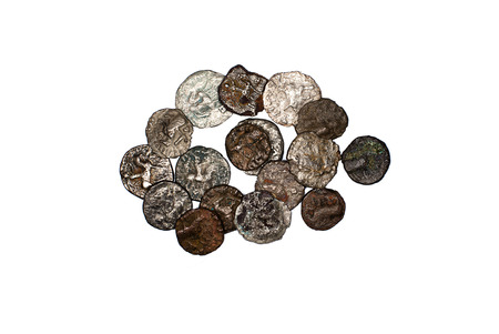 Many ancient bronze coins on white