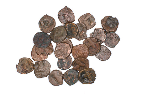 hoard: Many ancient bronze coins on white