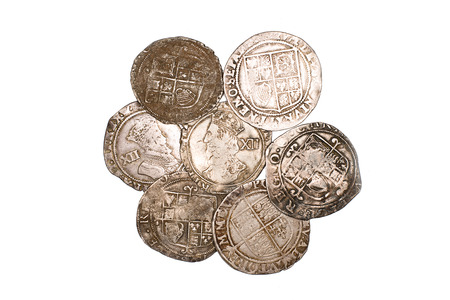Many ancient silver coins on white