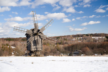 farina: Windmill against a blue sky with clouds Stock Photo