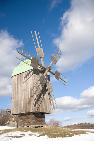 Windmill against a blue sky with clouds Stock Photo