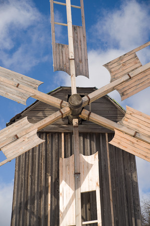 farina: The wings of a windmill against the sky with clouds Stock Photo