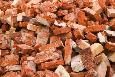 A lot of used bricks is lying big pile Stock Photo