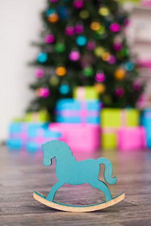 New years horse is on floor near Christmas tree