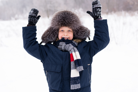 The boy is happy playing in the snow in the winter Stock Photo