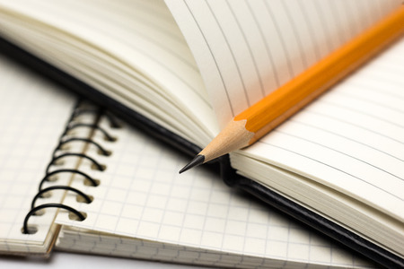 open notebook: Pencil on the pages of an open notebook