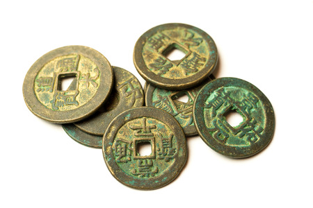 Ancient bronze coins of China on over white
