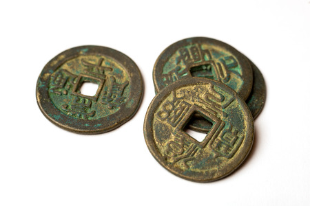 hoard: Ancient bronze coins of China on over white