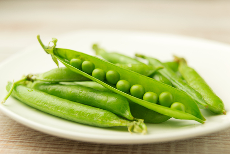 The ripe pods of green peas and grains