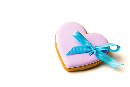 Cookies in the shape of heart with bow on white