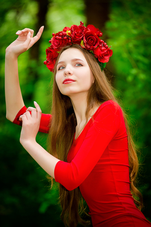 colleen: Young girl in wreath in the forest in summer Stock Photo