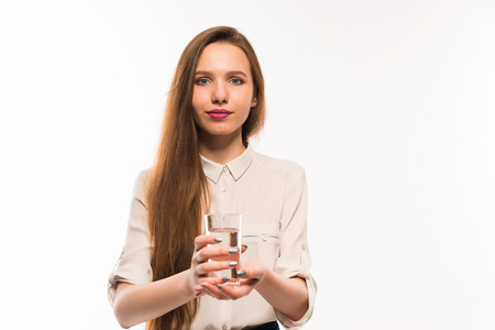 Young girl offers a glass of cool water