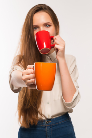 quencher: Young beautiful smiling girl holding a cup Stock Photo