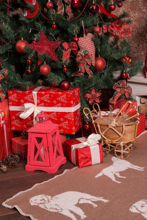 Many boxes with Christmas presents under the Christmas tree