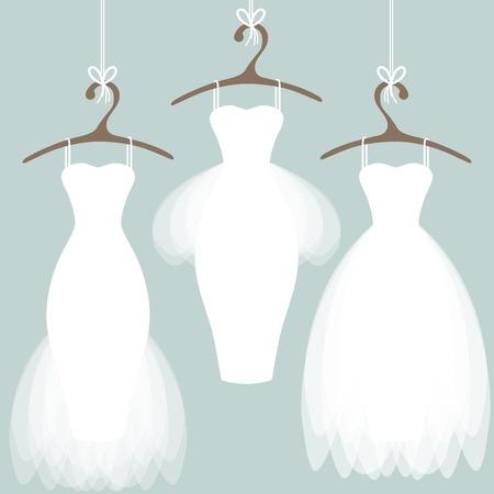 Trouwjurken op hangers. Pastel achtergrond