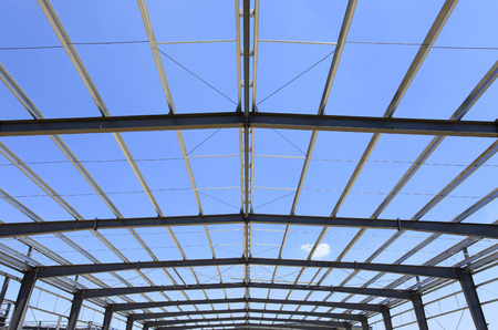 The steel structure under the blue sky white clouds photo